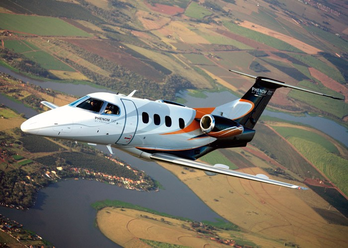 Phenom 100 in flight